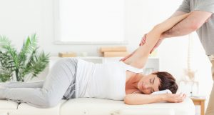 Chiropractic Care Common Myths Debunked | picture of chiropractor stretching womans arm