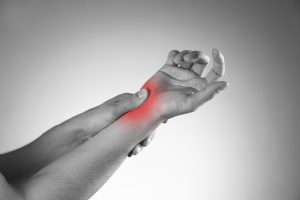 Active Release Techniques | picture of woman with carpal tunnel syndrome.jpg