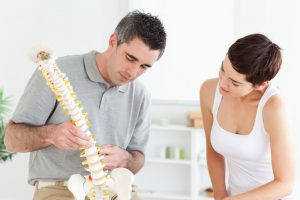 Chiropractic Care   chiropractor showing patient spine