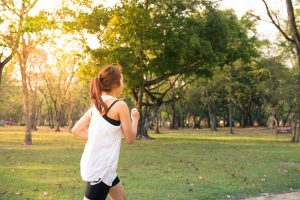 Wellness Tune-Up | picture of girl running through the park