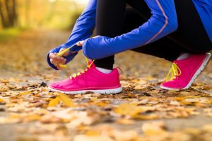 Prevent Shin Splints   image of woman lacing up her runners