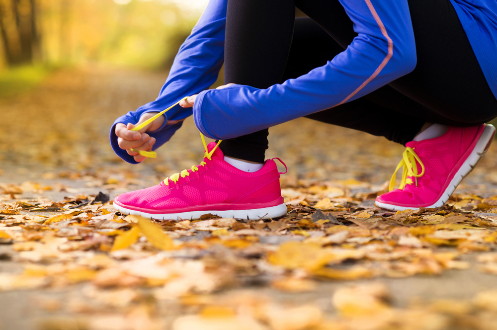 Prevent Shin Splints | image of woman lacing up her runners