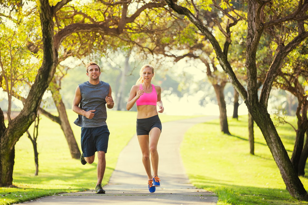 runners | picture of man and woman running on path